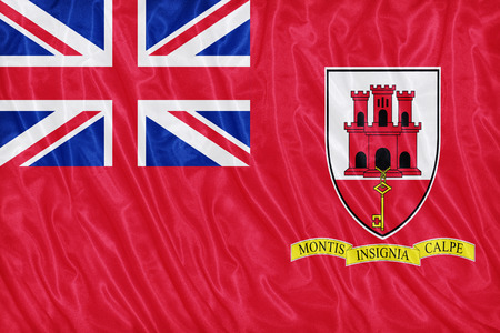 ensign: Civil Ensign of Gibraltar flag pattern on the fabric texture ,vintage style
