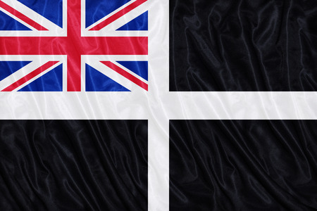 ensign: Unofficial Cornish Ensign flag pattern on the fabric texture ,vintage style Stock Photo