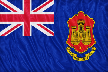 ensign: Government Ensign of Gibraltar flag pattern on the fabric texture ,vintage style