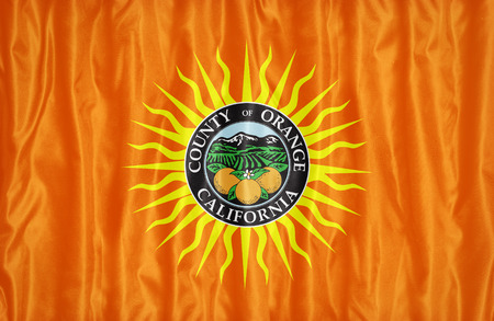 orange county: Orange County , California flag pattern on fabric texture, vintage style Stock Photo