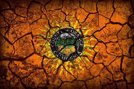 orange county: Orange County, California flag pattern on crack soil texture