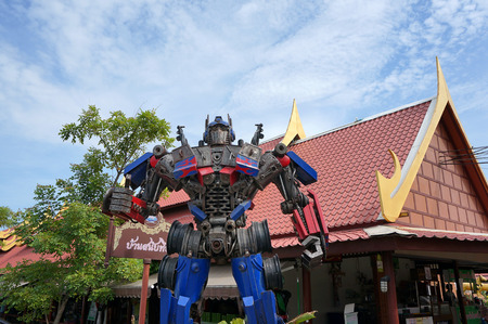 display figure: AYUTTAYA,THAILAND - JUNE 13, 2015 : The Replica of Optimus Prime robot made from iron part of a Car display at Thung Bua Chom floating market Editorial