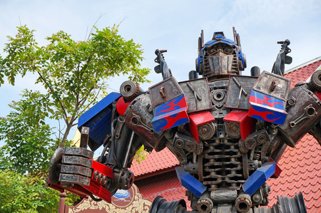 display figure: AYUTTAYA,THAILAND - JULY 13, 2015 : The Replica of Optimus Prime robot made from iron part of a Car display at Thung Bua Chom floating market