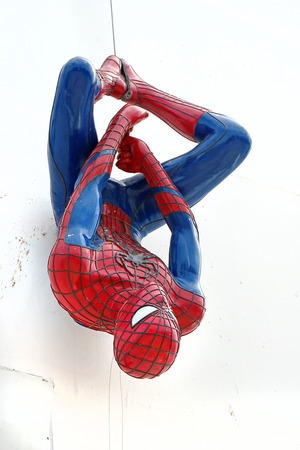 spider: AYUTTAYA,THAILAND - JUNE 13, 2015: Spider-Man model upside down on billboards at Thung Bua Chom floating market