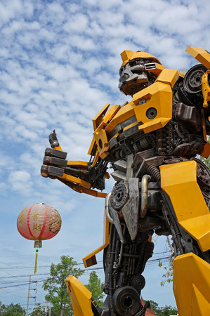 speed gun: AYUTTAYA,THAILAND - JUNE 13, 2015 : The Replica of Bumblebee robot made from iron part of a Car display at Thung Bua Chom floating market