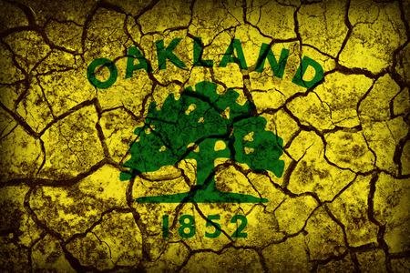 california flag: Oakland ,California flag pattern on crack soil texture,retro vintage style Stock Photo