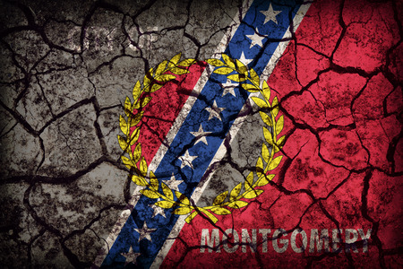 alabama flag: Montgomery ,Alabama flag pattern on crack soil texture,retro vintage style Stock Photo
