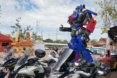 display figure: AYUTTAYA,THAILAND - AUGUST 09, 2015 : The Replica of Optimus Prime robot made from iron part of a Car display at Thung Bua Chom floating market