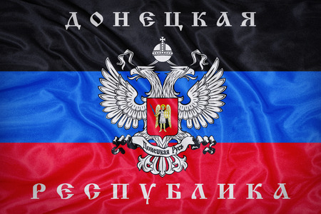 retrospective: Donetsk Republic political party flag pattern on fabric texture,retro vintage style Stock Photo