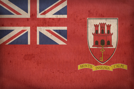 ensign: Civil Ensign of Gibraltar flag pattern on fabric texture,retro vintage style