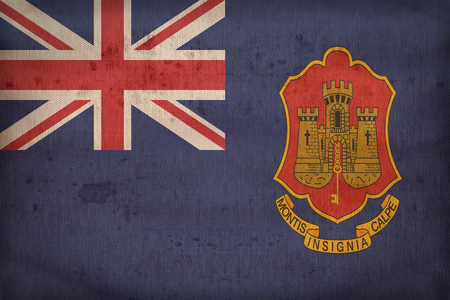 ensign: Government Ensign of Gibraltar flag pattern on fabric texture,retro vintage style Stock Photo