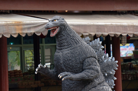 monster movie: AYUTTAYA,THAILAND - AUGUST 29, 2015 : A Godzilla model stand outdoor at Thung Bua Chom floating market Editorial