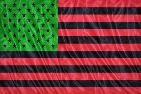 african america: African America flag pattern on the fabric texture ,vintage style