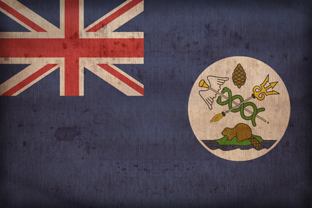 canadian state flag: Vancouver Island flag pattern on fabric texture,retro vintage style Stock Photo
