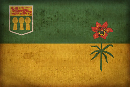 saskatchewan flag: Saskatchewan flag pattern on fabric texture,retro vintage style