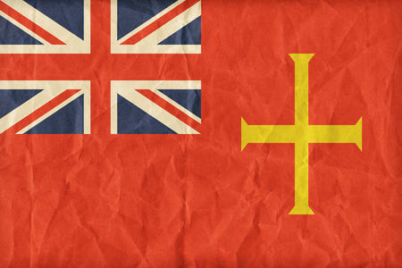 ensign: Civil Ensign of Guernsey flag pattern on paper texture,retro vintage style