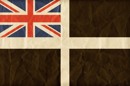 ensign: Unofficial Cornish ensign flag pattern on paper texture,retro vintage style Stock Photo