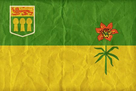 saskatchewan flag: Saskatchewan flag pattern on paper texture,retro vintage style