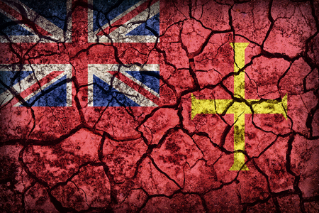 ensign: Civil Ensign of Guernsey flag pattern on crack soil texture,retro vintage style Stock Photo