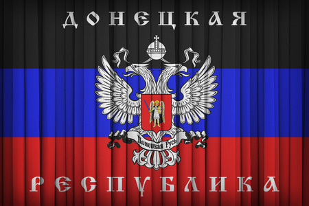 political party: Donetsk Republic Political Party flag on the fabric curtain,vintage style Stock Photo