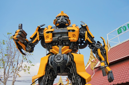 speed gun: AYUTTAYA,THAILAND - JANUARY 23, 2016 : The Replica of Bumblebee robot made from iron part of a Car display at Thung Bua Chom floating market Editorial