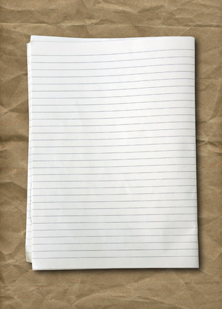 college ruled: white lined sheet of notepad paper on old paper