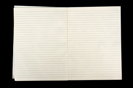 college ruled: white lined sheet of notepad paper on black background Stock Photo