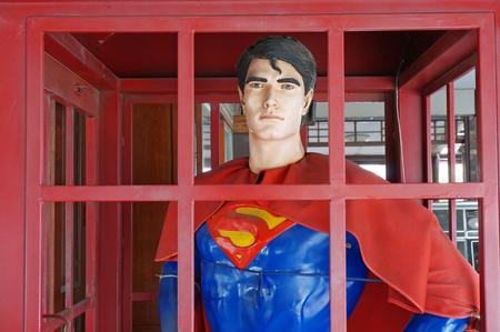 ayuttaya: AYUTTAYA ,THAILAND- JANUARY 23, 2016 : Superman model standing in a phone booth at Thung Bua Chom floating market