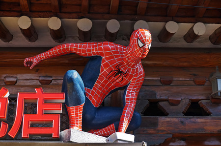 holiday movies: SEOUL,SOUTH KOREA - NOVEMBER 15, 2015: Spider-Man model sitting on the roof of the shop at Bukchon street market