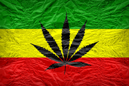 floyd: Rasta flag pattern with a marijuana leaf overlay on floyd of candy shell, vintage border style