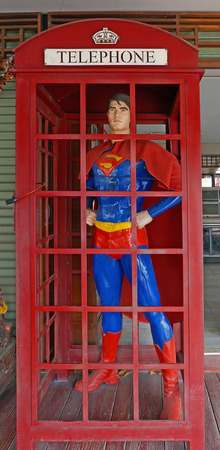 AYUTTAYA ,THAILAND- JANUARY 23 , 2016: Superman model standing in a phone booth at Thung Bua Chom floating market