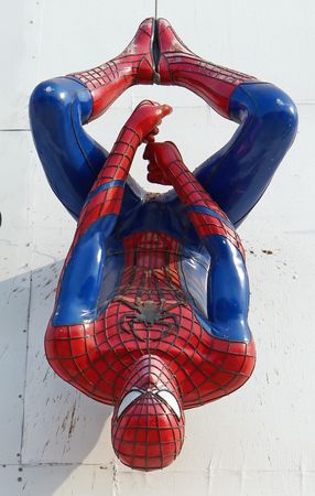 holiday movies: AYUTTAYA,THAILAND - FEBUARY 27, 2016: Spider-Man model upside down on outdoor billboards at Thung Bua Chom floating market