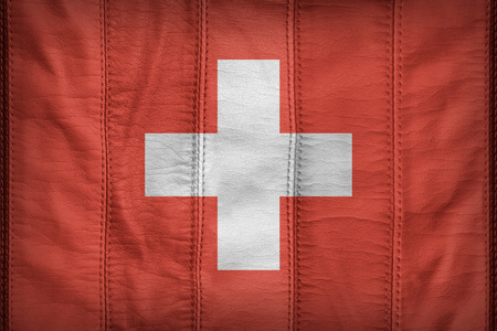switzerland flag: Switzerland flag pattern on synthetic leather texture
