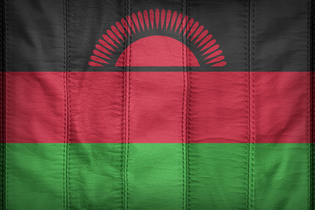 malawi flag: Malawi flag pattern on synthetic leather texture Stock Photo