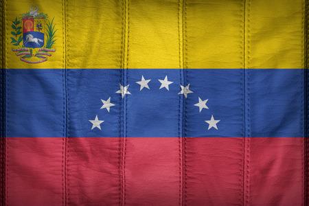 venezuela flag: State flag of Venezuela flag pattern on synthetic leather texture