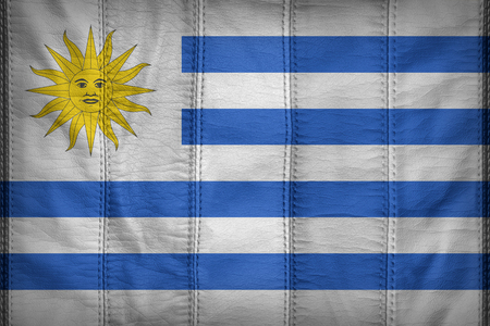 uruguay flag: Uruguay flag pattern on synthetic leather texture Foto de archivo