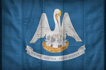 louisiana flag: Louisiana flag pattern on synthetic leather texture Stock Photo