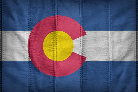 colorado flag: Colorado flag pattern on synthetic leather texture Stock Photo