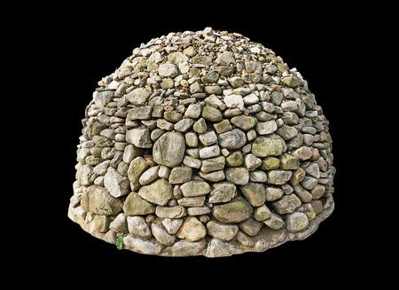 mound of stone on black background Stock Photo