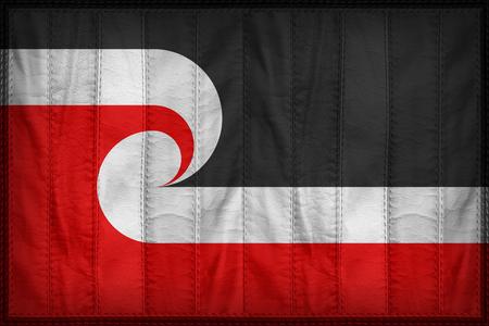 sovereignty: Tino Rangatiratanga Maori Sovereignty Movement flag pattern on synthetic leather texture Stock Photo