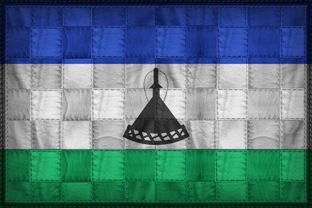 continente africano: Lesotho flag pattern on synthetic leather texture