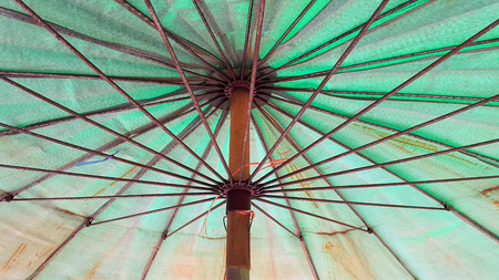 Bottom view of old umbrella