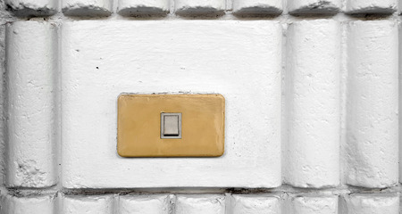 light switch  in the white brick wall