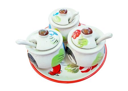 seasoning in the ceramic jars, Thailand style on white background