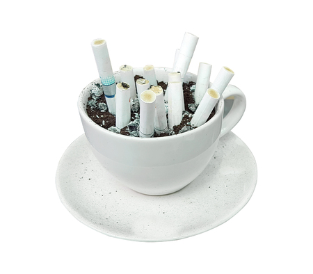 Coffee mugs and coffee grounds for cigarette butts. Stock Photo