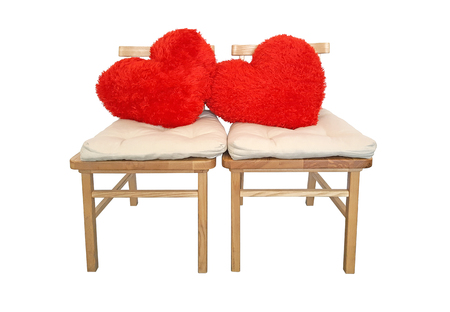 red heart pillow on chair