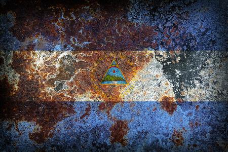 Nicaragua flag pattern on old rusty metal texture