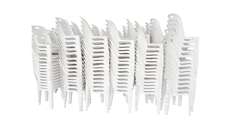 Stacked in rows of white plastic chair on white background