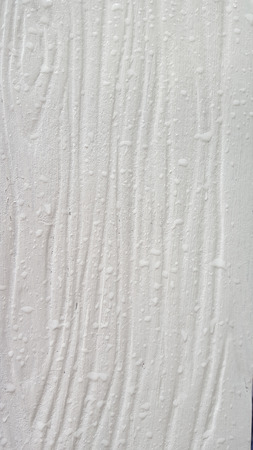 Close up the artificial wood siding after raining