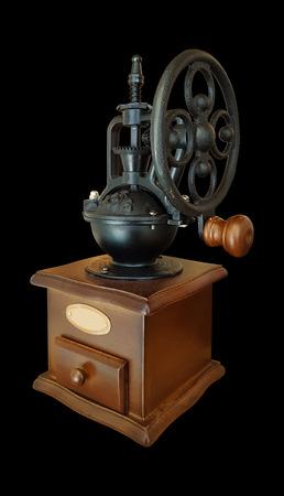 Ancient coffee grinder on black background Banco de Imagens